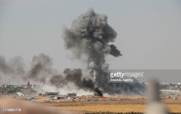 Smoke rises after Members of Syrian National Army continuing their operation as they hit terror targets in Syria's Ras al-Ayn to clear the town from...