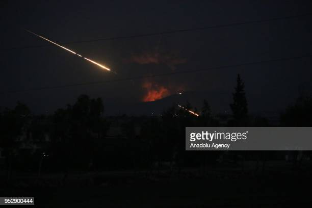 Smoke rises after military points of the 47th regiment of the Assad regime were hit on April 30 2018 in Hama Syria