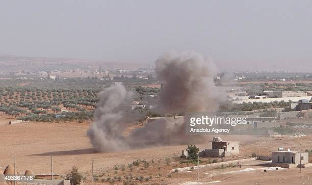 Smoke rises after opposition forces attack on Assad Regime forces at AlHadr Town of Aleppo Syria on October 19 2015