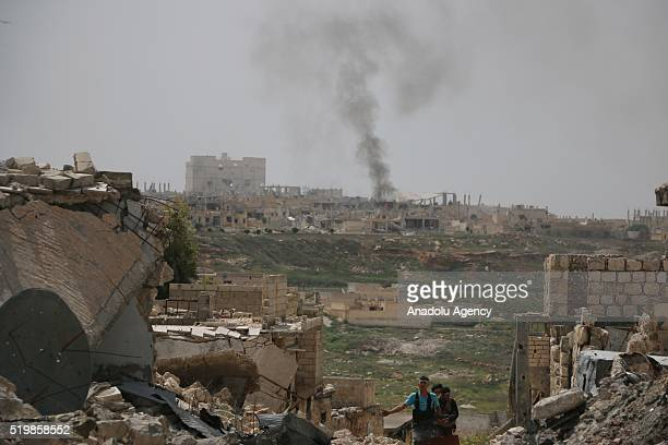 Smoke rises after Russian airstrikes hit opposition controlled areas as clashes between Syrian oppositions and regime forces continue at Handarat...