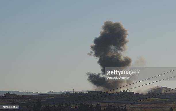 Smoke rises after Russian airstrikes hit residential areas in Tal Rifaat District of Aleppo Syria on February 09 2016
