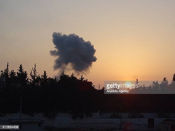 Smoke rises after Russian airstrikes hit residential areas in the the moderate oppositioncontrolled Kafr Hamrah village of Aleppo Syria on February...