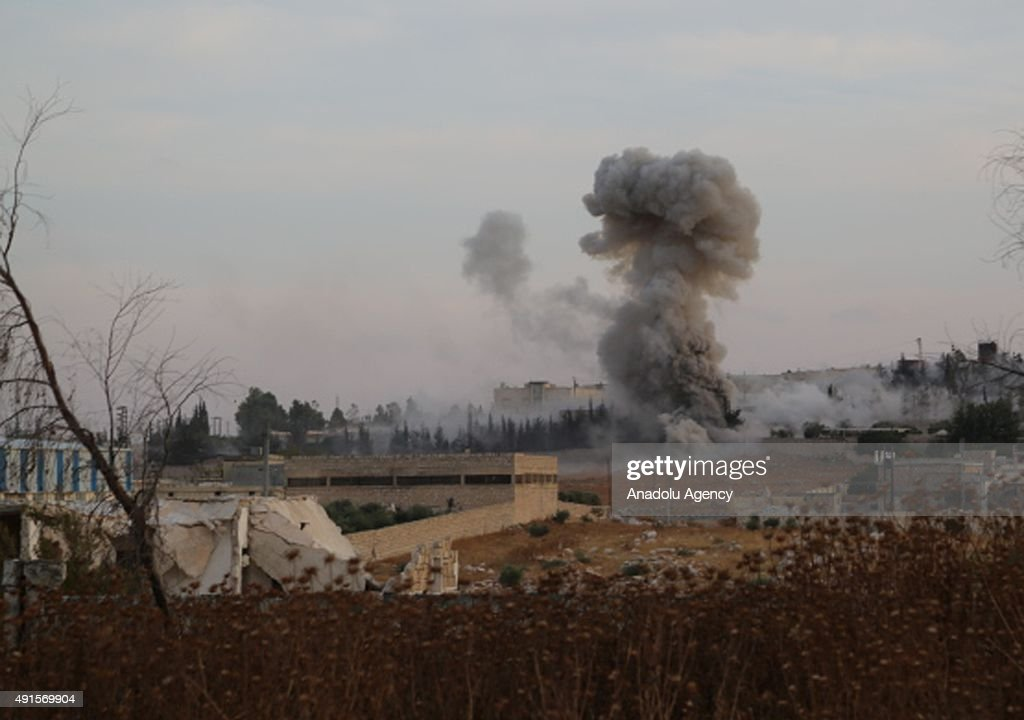 Smoke rises after Russian airtrikes hit ammunition-stores and bases of two opposition groups, in Mansoura region in the west of Aleppo, Syria on October 06, 2015.