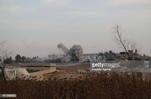 Smoke rises after Russian airtrikes hit ammunitionstores and bases of two opposition groups in Mansoura region in the west of Aleppo Syria on October...