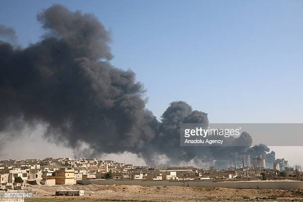 Smoke rises after Russian forces airstrike over opposition controlled cement plant located in southeast of Aleppo Syria on August 09 2016