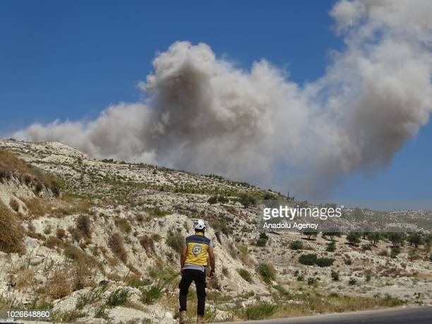 Smoke rises after Russian warplanes hit many civilian residential areas in Jisr alShughur City areas of Basanqul Ghani Innab Sirmaniyah west of Idlib...