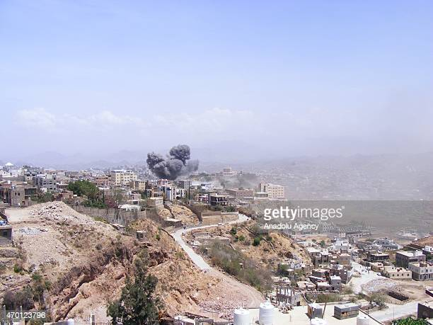 Smoke rises after Saudi-led coalition airstrikes hit office of the president under control of Ensarullah Movement in Taiz city of Yemen on April 17,...