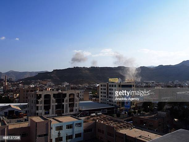 Smoke rises after Saudiled coalition carried out airstrike in Sanaa Yemen on March 30 2015 as part of the 'Decisive Storm' operation against the...