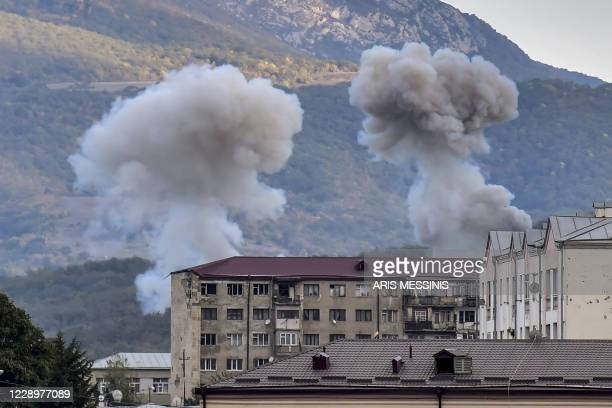 Smoke rises after shelling in Stepanakert on October 9 during ongoing fighting between Armenia and Azerbaijan over the disputed region of...