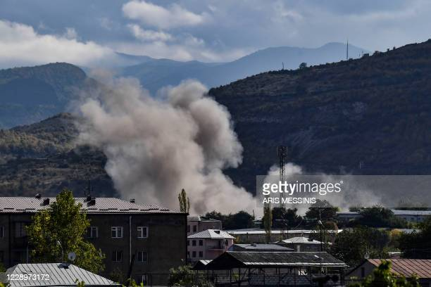 Smoke rises after shelling in the city of Stepanakert on October 9 during the ongoing fighting between Armenia and Azerbaijan over the disputed...