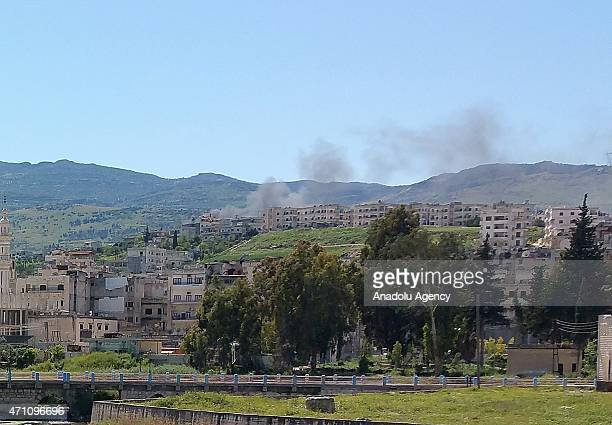 Smoke rises after Syrian regime forces carried out a vacuum bomb attack on residential areas in the town of Jisr alShughur near Idlib Syria on April...