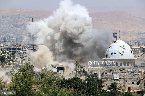Smoke rises after the attack launched by Assad regime forces to the residential areas in Jobar municipality of Damascus, Syria on July 27, 2015.