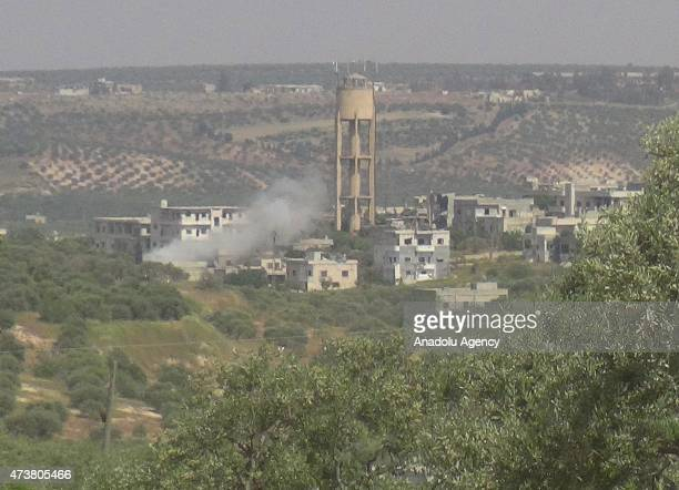 Smoke rises after the members of alFatah forces attack on Syrian regime forces' located in the al Mastumah village of Idlib Syria on May 17 2015