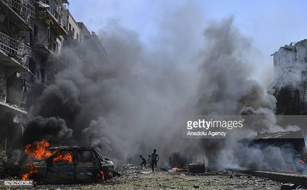 Smoke rises after the Syrian and Russian army warcrafts targeted Firdevs neighborhood of Aleppo Syria on July 14 2016