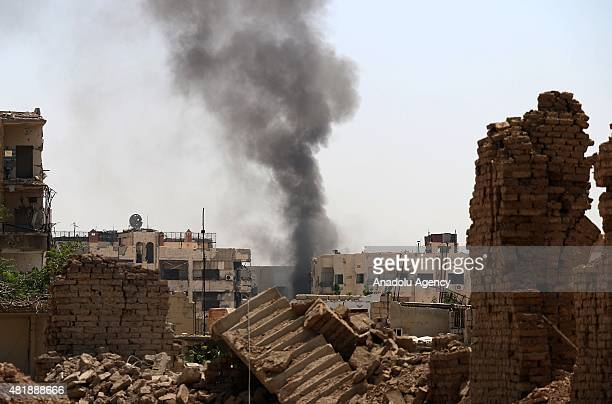Smoke rises after the Syrian regime forces airstrikes hit the residential areas of Jobar region in eastern Damascus Syria on July 25 2015