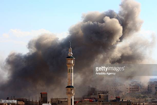 Smoke rises after the war crafts belonging to the Russian army carried out airstrikes on the residential areas in the town of Arbin in the Eastern...