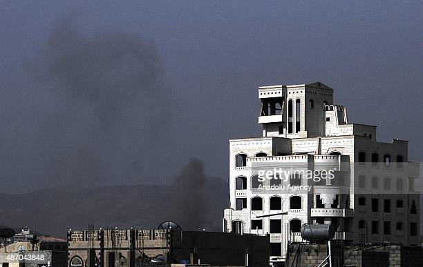 Smoke rises after the war crafts belonging to the Saudiled coalition carried out airstrikes Houthi targets in Sana'a Yemen on September 5 2015