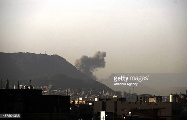 Smoke rises after the war crafts belonging to the Saudiled coalitions bomb Hara and Hurafi camps that belong to the Houthis in Sana'a Yemen on...
