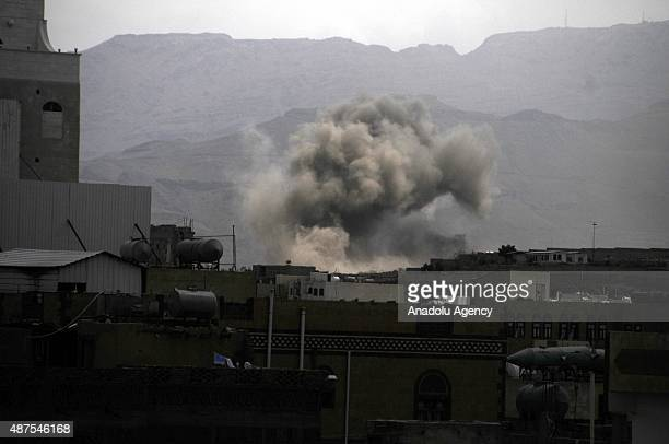 Smoke rises after the war crafts belonging to the Saudiled coalitions bomb Houthi controlled areas in Sana'a Yemen on September 10 2015
