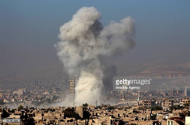 Smoke rises after the war crafts belonging to the Syrian army bombed the opposition controlled Jobar district of Damascus Syria on October 15 2015