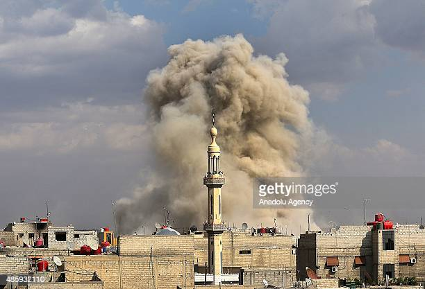 Smoke rises after the war crafts belonging to the Syrian army hit the residential areas in Hamuriye neighborhood of Damascus, Syria on August 30,...