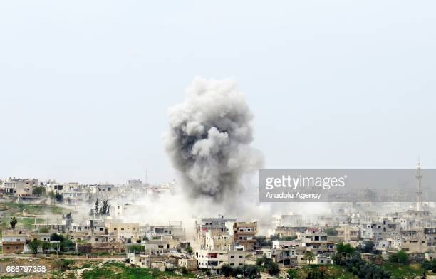 Smoke rises after the war crafts belonging to the Syrian Regime Forces bombed the Menshiyye neighborhood as Syrian military opposition advance...