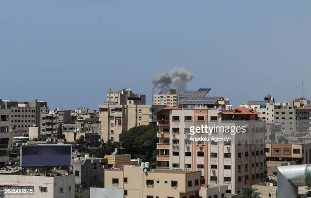 Smoke rises after the warplanes of Israel carried out an airstrike over residential areas in Gaza City Gaza on May 29 2018