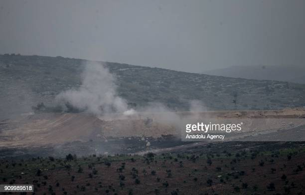 Smoke rises after Turkish Armed Forces' howitzers fire from Turkey's Syria border Hatay within the 'Operation Olive Branch' against PYD/PKK in Afrin...