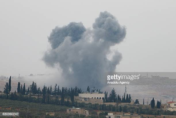 Smoke rises after Turkish Army's airstrike over Daesh terrorists' positions as Free Syrian Army move forward to the center of alBab district during...