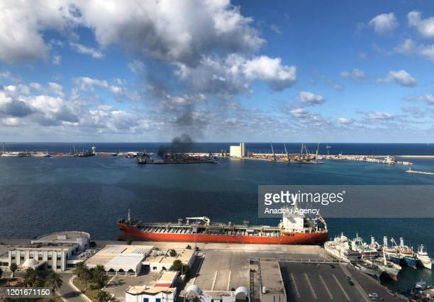 Smoke rises after warlord Khalifa Haftarâs forces launched an attack on a port near the Martyrs' Square, where celebration events marking the 9th...