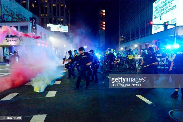 Smoke rises around police as they spray pepper spray during clashes with protesters after a demonstration over the death of George Floyd an unarmed...