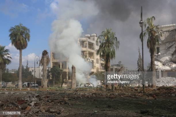 Smoke rises around the damaged buildings at the site after the consecutive bomb attacks with two bombladen vehicles in Idlib city centre Syria on...