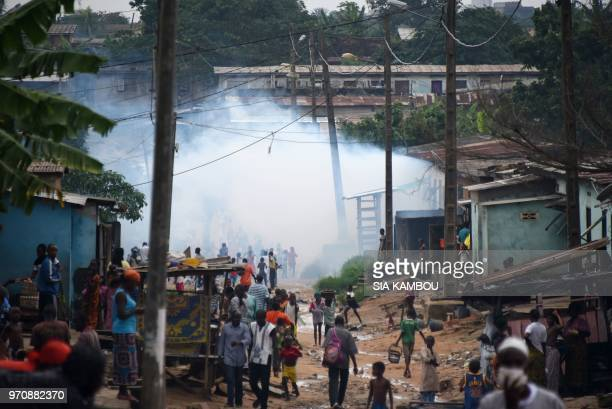 Smoke rises as agents of the National Institute of Public Hygene carry out fumigation in the Anyama district of Abidjan on June 9 as part of the...