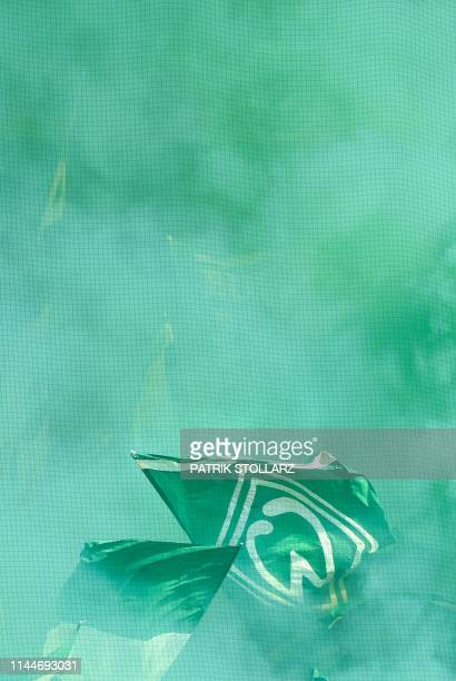 Smoke rises as Bremen's fans wave flags after the German first division Bundesliga football match between Werder Bremen and RB Leipzig in Bremen...