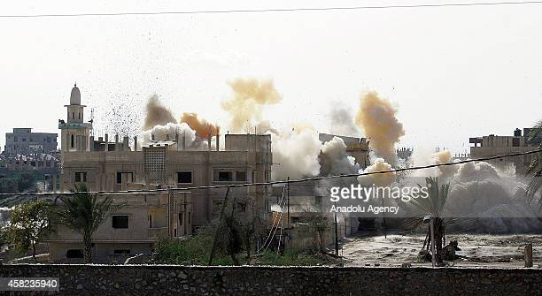 Smoke rises as Egyptian army blows up the buildings as part of an operation aiming to create a buffer zone at the Rafah border in Egypt, on November...