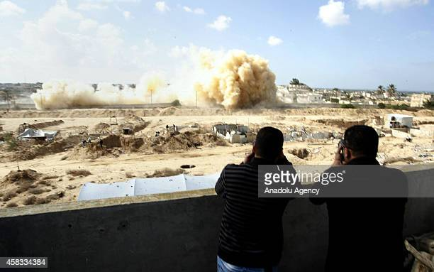 Smoke rises as Egyptian army blows up the buildings as part of an operation aiming to create a buffer zone at the Rafah border in Egypt on November 3...