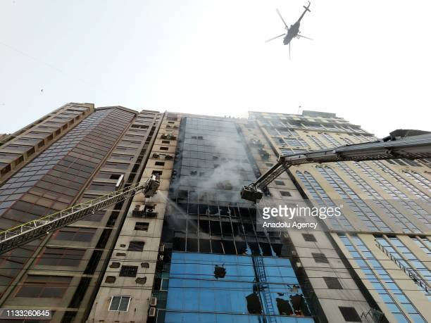 Smoke rises as firefighters try to extinguish fire broke out at a highrise in Dhakas Banani what was yet to be brought under control even after three...