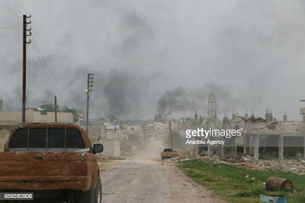 Smoke rises as Free Syrian Army and other Syrian opponent groups continue to attack to Assad Regime Forces and break through the center of Hama Syria...