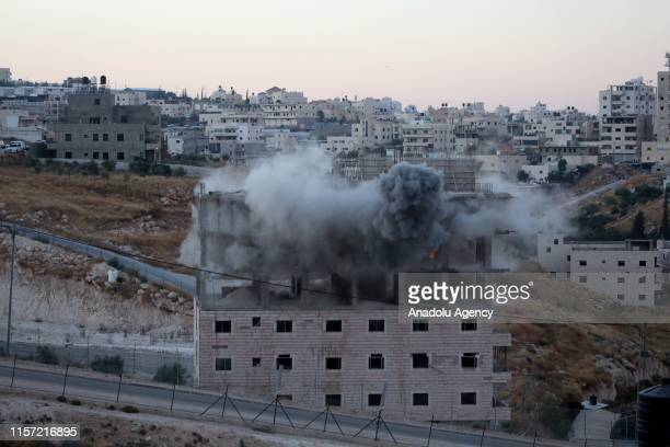 Smoke rises as Israeli forces begin to raze a building on the grounds that the building was close to the wire barriers which is continuation of the...