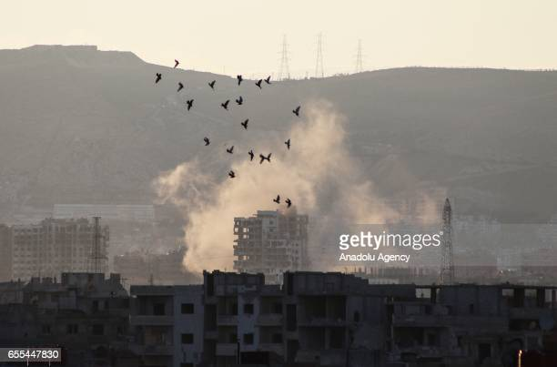 Smoke rises as opposition forces clash with Assad regime forces' in Jobar district of Damascus Syria on March 20 2017 Assad regime forces were moving...