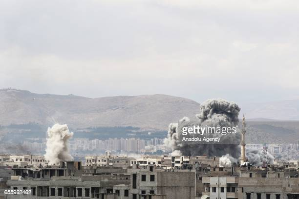 Smoke rises as opposition forces clash with Assad regime forces' in Jobar district of Damascus, Syria on March 20, 2017. Assad regime's fighter jets...