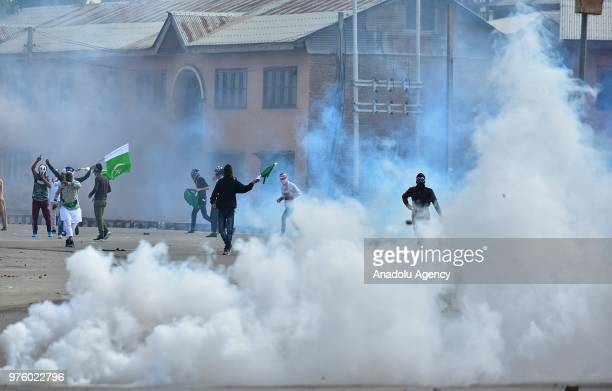 Smoke rises as pro freedom protesters clash with Indian paramilitary soldiers during an antiIndia protest after Eid alFitr prayer on the Eid alFitr...