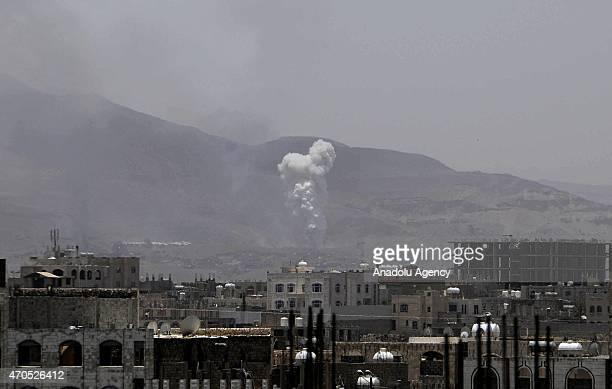 Smoke rises as Saudiled coalition air strikes hit the Houthi targets in the Hamdan region northwest of Sanaa Yemen on April 21 2015