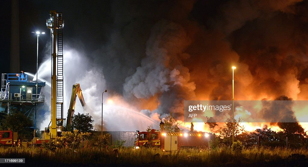Smoke rises as Swedish fire fighters battle to quell the flames of a major blaze at a recycling station in Malmo, southern Sweden late night on June 27, 2013. The fire broke out around 7pm on June 27, 2013 and got a second boost early Friday morning June 28, 2013 after an explosion within the scrap heap. No people were reported injured.
