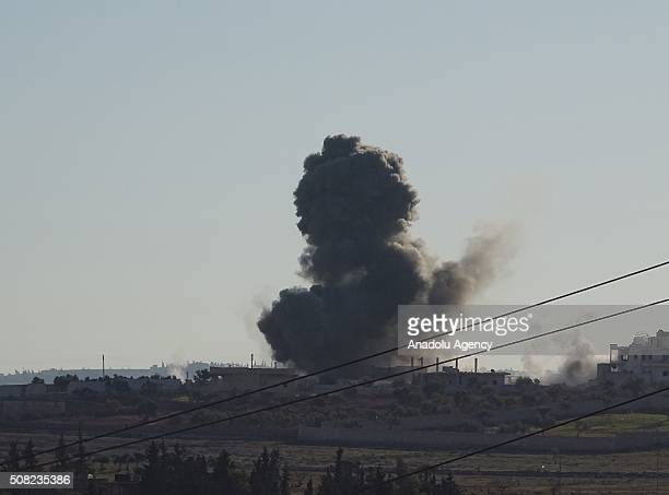 Smoke rises as Syrian opposition forces attack regime controlled Rtyen village with howitzers in Aleppo Syria on February 3 2016