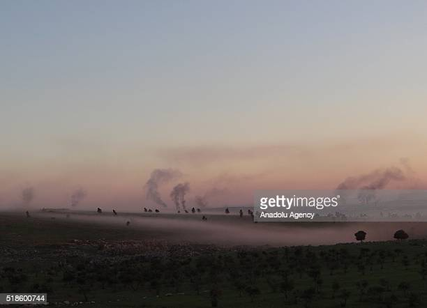 Smoke rises as Syrian opposition forces attack regime positions with heavy weapons, at Ays district of Aleppo, Syria on April 1, 2016.