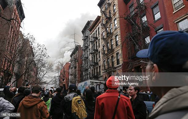 Smoke rises as the firefighters extinguish a fire caused by a blast occurred at a building in East Village district of New York United States on...