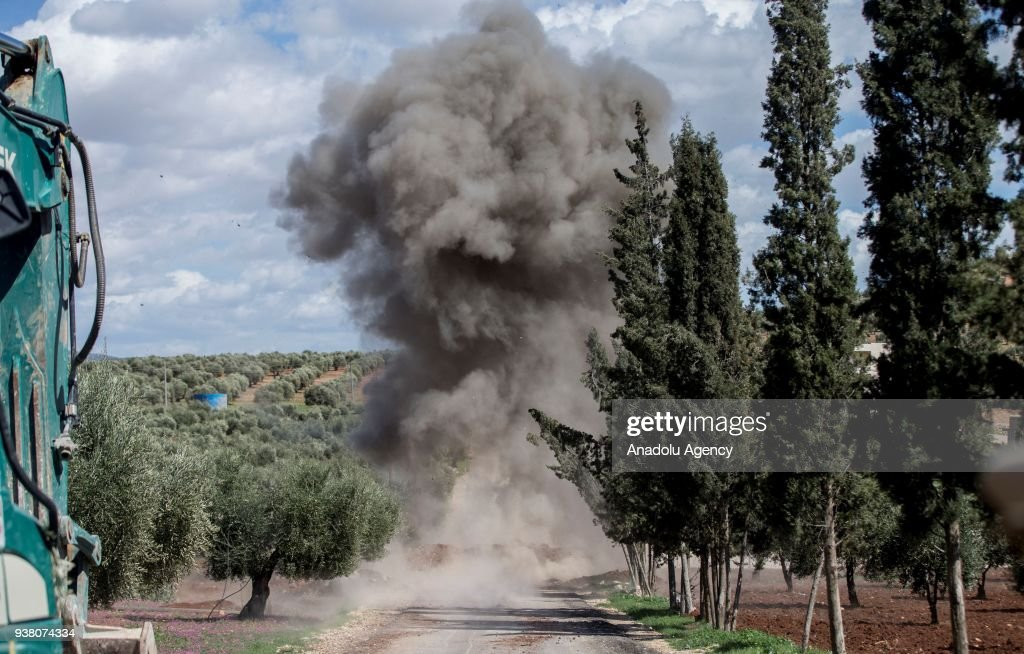 Smoke rises as Turkish soldiers conduct search works for explosive ordnances, including improvised explosive devices and mines with a sniffer dog named as leylak after Turkish Armed Forces and Free Syrian Army (FSA) took complete control of northwestern Syria's Afrin within the 'Operation Olive Branch', on March 26, 2018. After the Turkish military and Free Syrian Army liberated the Afrin town center from YPG/PKK and Daesh terrorists, fresh aerial footage showed that the civilians and buildings there remained unharmed. The Turkish troops and Free Syrian Army fighters took control of the Afrin town center on March 18, 2018 as part of Operation Olive Branch, which was launched on Jan. 20 to clear the area of YPG/PKK-Daesh terrorists.