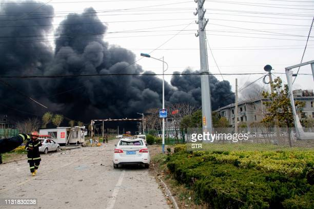 Smoke rises at an explosion site in Yancheng in China's eastern Jiangsu province on March 21 2019 A huge explosion rocked a chemical plant in eastern...
