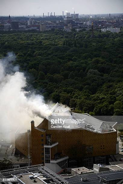 Smoke rises at the Berlin Philharmonic near Potsdamer Platz on May 20 2008 in Berlin Germany as fire fighters try to extinguish a fire A fire broke...